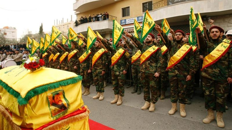 Fighters of Hezbollah attend the funeral of a comrade who died in Syria in Kfar Hatta. (Mahmoud Zayyat / AFP) via pow.photos