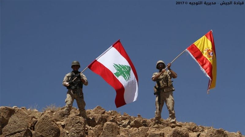 Lebanese Army Raising Both the Lebanese and Spanish Flags After Advancing on ISIS Holds in Lebanon and Following the Terrorist Attack in Spain