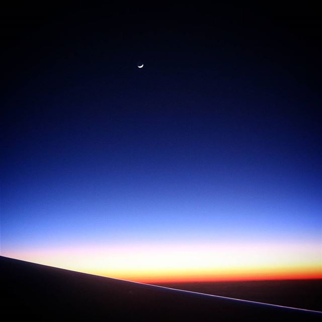 Sunset from the Plane.. i was lucky enough to catch the moon!...