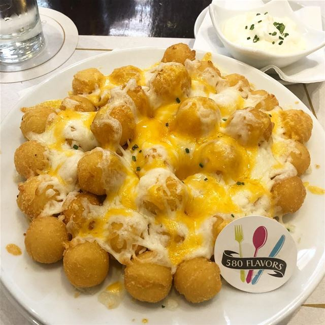 Potato balls topped with cheese and extra amount of cheese 🧀 😋👌 so... (Achrafieh, Lebanon)